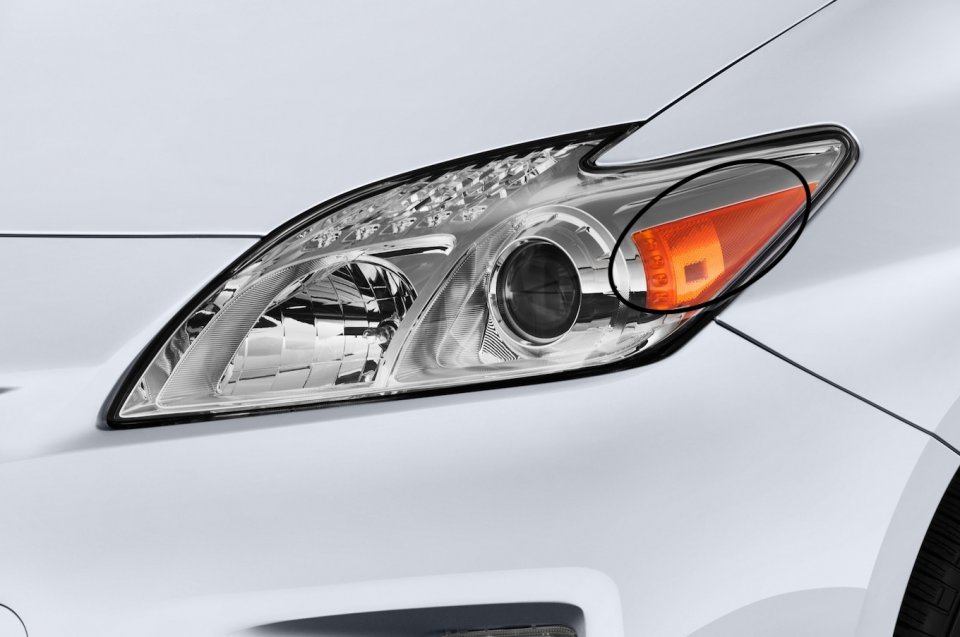 2015-toyota-prius-hybrid-three-hatchback-headlight.png.jpeg